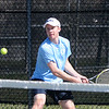 BRYAN EATON/Staff Photo. Triton first singles Barrett Towns.