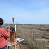 JIM VAIKNORAS/Staff photo Noelle Poulx-Decain paints a scene off the Plum Island Turnpike in Newbury Monday afternoon.