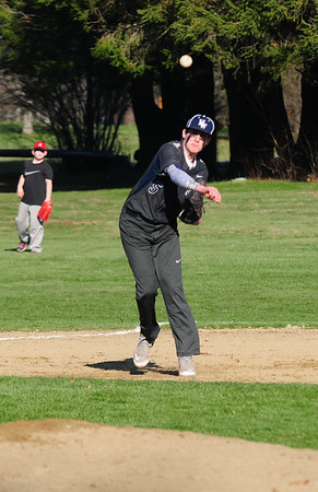 JIM VAIKNORAS/Staff photo Hamilton Wenham's Michael Crowley throws out an Amesbury runner during their game at Patton Park in Hamilton.