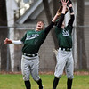 BRYAN EATON/Staff Photo. Pentucket centerfielder, left, and right fielder make a catch.
