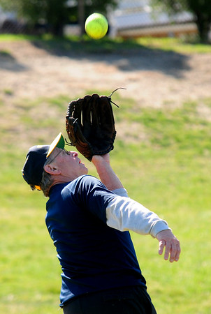 JIM VAIKNORAS/Staff photo Over 60 softball player Matt LaScola, 74, fields a fly ball at Carl Thomas Field in North Andover.