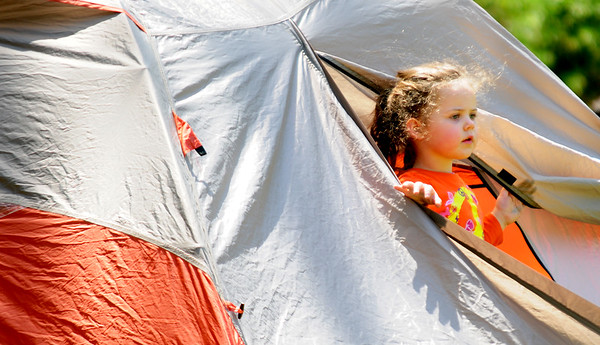 JIM VAIKNORAS/Staff photo Isabel Millilea, 3, of Andover checks out a tent during the 100th Birthday party for the Harold Parker State Forest Saturday. Almost 700 people attended the event enjoying cake , hot dogs, games, fishing, and programs to learn about the history of the forest.