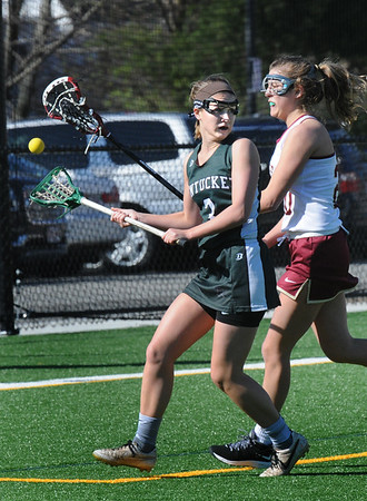 BRYAN EATON/Staff Photo. Newburyport midfielder Olivia Kearney tips the ball from Pentucket's Cal Moolic.