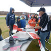 JIM VAIKNORAS/Staff photo Daren Hudson of the Academy of Model Aeronautics talks about one of is Radio Controled planes to members of Boy Scout Troop 44 at Plum Island Airport RC Club Appreciation Day Saturday.
