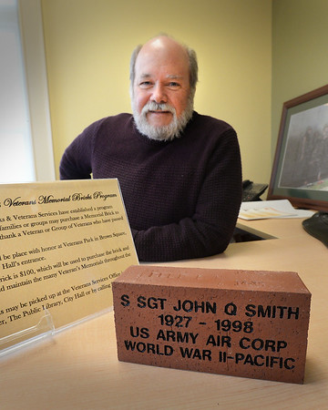 BRYAN EATON/Staff Photo. Veterans officials in Newburyport will soon sell bricks for $100 each to be engraved and put into Brown Square to remember a deceased soldier. Showing a sample brick is committee member Dan Raycroft.