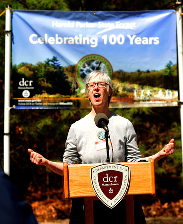 JIM VAIKNORAS/Staff photo Pat Keck, president of the Friends of the Harold Parker State Forest, speaks during their 100th Birthday party Saturday. Almost 700 people attended the event enjoying cake , hot dogs, games, fishing, and programs to learn about the history of the forest.