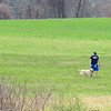 JIM VAIKNORAS/Staff photo A man and his dog enjoy a nice spring day at Battis Farm in Amesbury.
