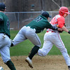 BRYAN EATON/Staff Photo. Pentucket third baseman Steve Noyes tags Masconomet's Manni as the tried to make it back to second base.