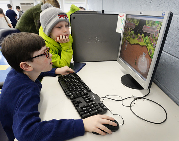 BRYAN EATON/Staff Photo. Jake Sherman, 10, right, watches his friend Tristan Scully, 9, both of Newburyport play a game of Prodigy in the computer room at the Boys and Girls Club. He was trying to beat an earlier score in this game that uses a lot of mathematics.