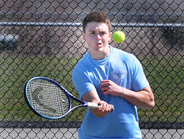 BRYAN EATON/Staff Photo. Triton's Drew Lapham in second doubles.