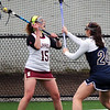 BRYAN EATON/Staff Photo. Newburyport's Cescily Wheeler looks for an open teammate from behind the Lynnfield net.