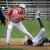 BRYAN EATON/Staff Photo. The throw is last to Masconomet shortstop Romanowski as Pentucket's Mitch Murray makes the steal at second base.