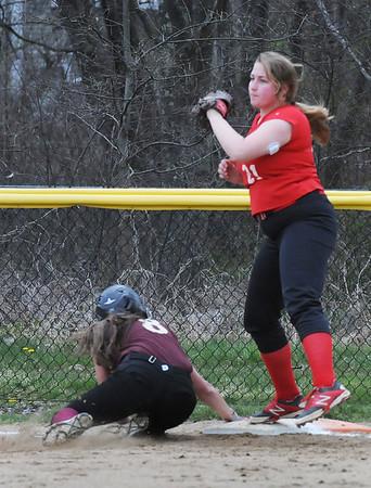 BRYAN EATON/Staff Photo. Masconomet's first baseman has the ball forcing out Newburport's Salvatore.
