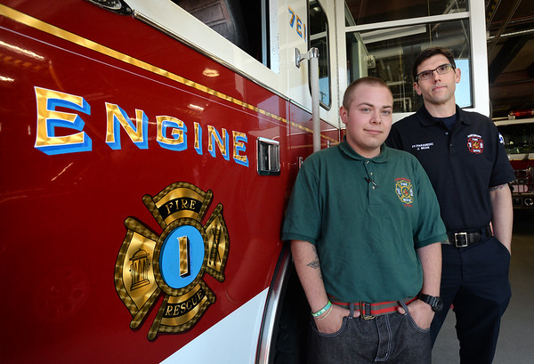 BRYAN EATON/Staff Photo. Tyla Hamel, left, a student at Amesbury Innovation High School, did an eight week internship at the Amesbury Fire Department with guidance from firefighter and paramedic Jeremy Bean and others.