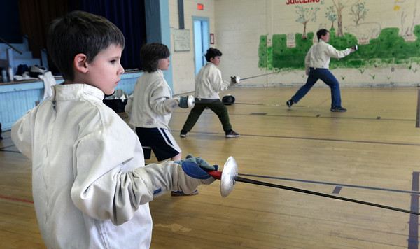 BRYAN EATON/Staff Photo. Declan Hyer, 8, and other practice their  fencing moves from instructor Jack Mullarkey of the 3MB Fencing Club on Tuesday. The class is one of several Newburyport Youth Services is providing during school vacation week.