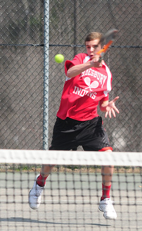 JIM VAIKNORAS/Staff photo Amesbury's Chris Chabet returns a ball during his 1st doubles match against Triton at Amesbury.
