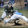 BRYAN EATON/Staff Photo. Pentucket catcher Jackson McKean has the ball forcing out Triton's #1 at home plate.