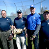 JIM VAIKNORAS/Staff photo Over 60 softball players Ed Manzi 62, Les Mencis,78, Kevin Twohig , 72, and Matt LaScola, 74 at Carl Thomas Field in North Andover.