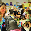 "Newburyport: Nicole Brennan, director of the YWCA Children's Center gives an apple chip in her lips for a kiss with Daisy the Potbellied Pig. Farmer Minor and Daisy visited the center for a program ""Pig Out on Reading"" to get children more interested in books. Bryan Eaton/Staff Photo"