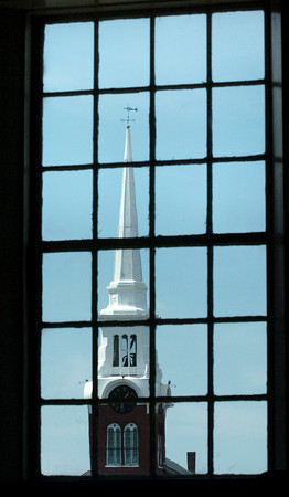 Newburyport: Eight church steeples can be seen in the downtown Newburyport area including the Central Congregational Church as framed in a window of First Religious Society (Unitarian Universalist). Bryan Eaton/Staff Photo