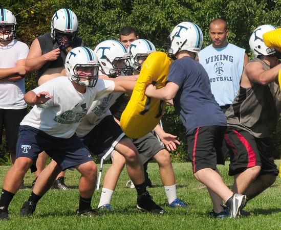 Byfield: The Triton High School football team's defense goes through drills yesterday. Bryan Eaton/Staff Photo
