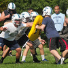 Byfield: The Triton High School football team's defense goes through drills yesterday. Bryan Eaton/Staff Photo