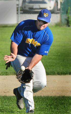 Rowley: Rowley Rams' third baseman Koby Thibault scoops the ball to pass to first baseman Nick Libouri to force Beverly's Pat Doyle out. Bryan Eaton/Staff Photo