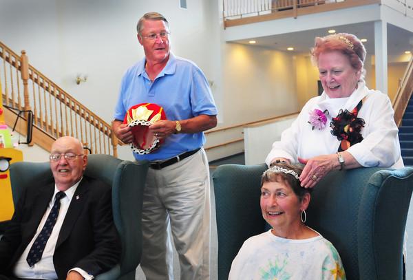 Newburyport: Larry Quinn of Salisbury and Joyce Cejka of Newburyport are crowned Yankee Homecoming 2013 Senior King and Queen by last year's royalty Paul Kolman and Peg McClure. Bryan Eaton/Staff Photo
