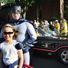 Newburyport: Mia Yim, 9, of Newburyport has her photo taken with Batman in front of the Batmobile. Bryan Eaton/Staff Photo