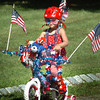 Newburyport: Justina Bucknill, 4, of Newbury drives a patriotic themed bike in the Kids Day in the Park Bicycle and Carriage Parade. Bryan Eaton/Staff Photo
