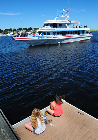 Newburyport: Monday's nice weather was great for outdoor activities including a whale watch on the Captain's Lady III, seen heading back to port at the Newburyport Waterfront. Bryan Eaton/Staff Photo