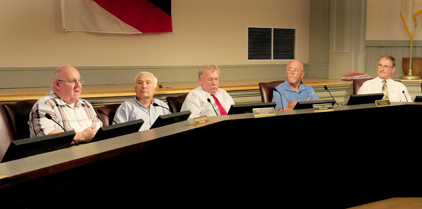 Salisbury: Salisbury selectman Don Beaulieu, left, speaks his turn on whether to unseat liquor commissioner Gil Madeiros. Other members, from left, Fred Knowles, Freeman Condon, Ed Hunt and Henry Richenburg. Bryan Eaton/Staff Photo