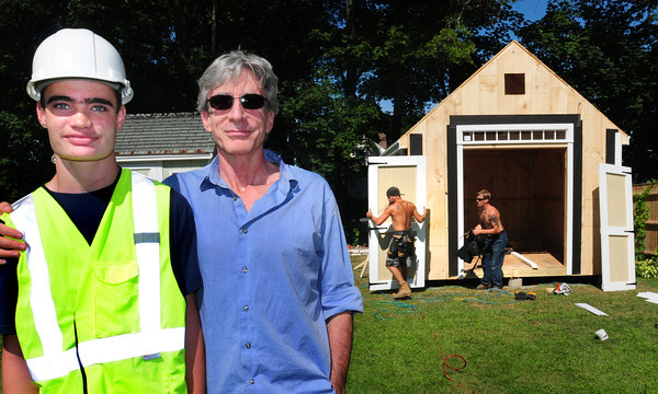 Newburyport: Eoin Robertson, with his father, Ken, is getting a clubhouse built in his back yard, courtesy of the Make-A-Wish Foundation. Bryan Eaton/Staff Photo