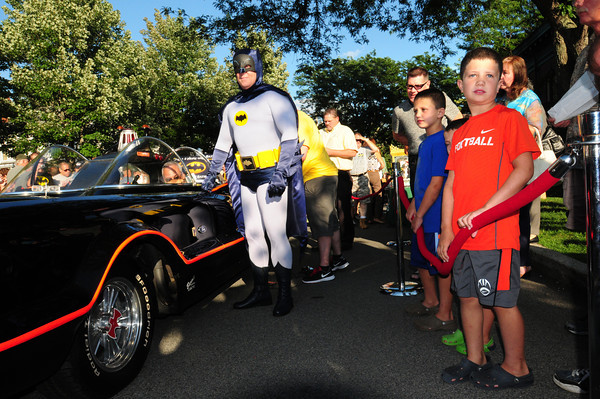 Newburyport: Batman poses for pictures in the Institution For Savings on State Street. People could have their photo taken in the Batmobile for $100 with the money going to the Boys and Girls Club. Bryan Eaton/Staff Photo