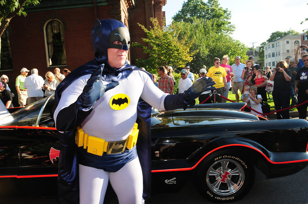 Newburyport: Batman poses for throngs of visitors to the car show Thursday night in downtown Newburyport. Bryan Eaton/Staff Photo