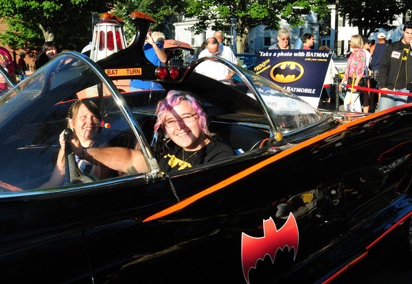 Newburyport: Libby Cook, 11, left, and her sister, Tori, 16, of Seabrook had the $100 donated by family to get their photo taken in the Batmobile with the money going to the Boys and Girls Club. Bryan Eaton/Staff Photo
