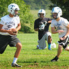 Byfield: Triton quarterback Brad Whitman, left, hands off during practice. Bryan Eaton/Staff Photo