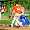 Rowley: Rowley Rams' Mike White slides in for a run after the Beverly catcher missed a pitch. Bryan Eaton/Staff Photo