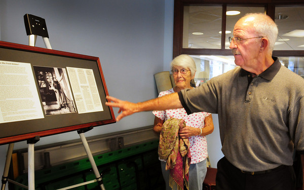 Newburyport: David Kelleher and his sister, Maureen Kelleher Miner, unveil a photo and text of their late father, Frank Kelleher, at the Newburyport Public Library which will hang in the Newburyport Archival Center there. Their father was a dedicated employee there in the 1930's and firmly believed in a libraries place for educating the public. Bryan Eaton/Staff Photo