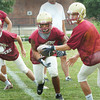 Newburyport: The Newburyport High football teams offense practices handoffs yesterday. Bryan Eaton/Staff Photo