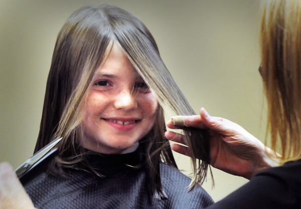 Newburyport: Stella Ridolfi, 9, of Newburyport gets her hair cut by Elaine Devereaux at the Inn Street Barbershop in Newburyport. The youngster starts classes at the Brookwood School in Manchester while her friends who go to Newburyport schools start Wednesday. Bryan Eaton/Staff Photo