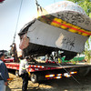 Salisbury: Tilly the Whale is lowered onto a flatbed truck to be transported to Haverhill's Adamson Industries where it will be reburbished and return to Salisbury town-owned land in the spring. Bryan Eaton/Staff Photo
