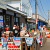 Salisbury: Scores of people came and went taking photos of the demolition of the Sidewalk Cafe at Salisbury Beach. Bryan Eaton/Staff Photo
