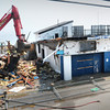 Salisbury: An excavator works its way south demolishing the Sidewalk Cafe at Salisbury Beach. Bryan Eaton/Staff Photo