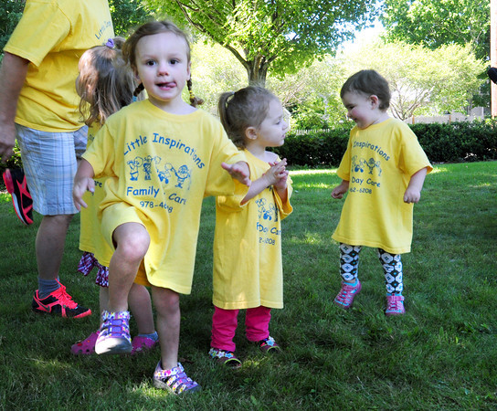 """Salisbury: Youngsters from Little Inspirations Family Day Care dance to """"Knees Up Mother Brown"""" sung by local singer and musician Nancy Sweeney. She was performing at the Salisbury Public Library's Children's Summer Program. Bryan Eaton/Staff Photo"""