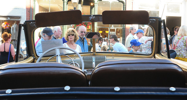 Newburyport: The crowd passes by through in a view of the windshield of a Ford 1947 Super Deluxe. Bryan Eaton/Staff Photo
