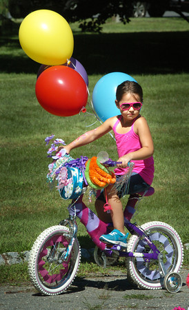 Newburyport: Ava Arsenault, 5, of Byfield has helium-filled balloons for her bike at Kids Day in the Park. Bryan Eaton/Staff Photo