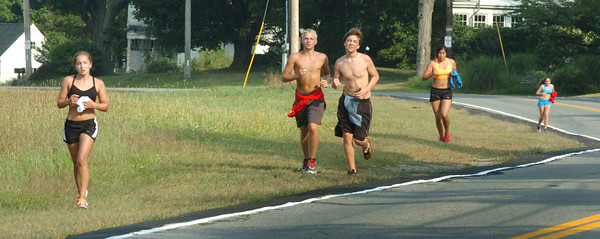 Amesbury: Amesbury High cross country team finishes up their practice run at Woodsom Farm on Tuesday morning. Bryan Eaton/Staff Photo