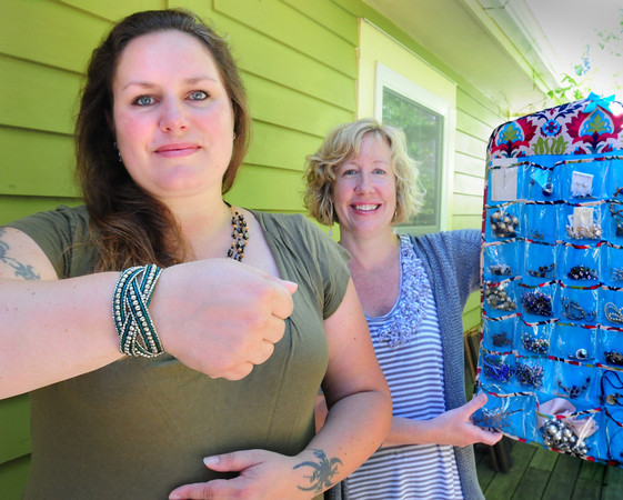 Newburyport: Bethany Groff, left, had her jewelry stolen on a trip and her friend, Tracy Neff, organized other friends to get her new pieces to replace those that were lost. Bryan Eaton/Staff Photo