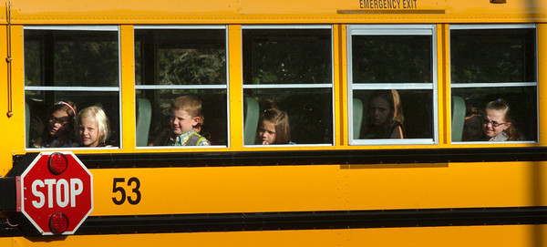 Newburyport: Anxious faces peer out the school bus as these students wait to unload at the Bresnahan School in Newburyport for the first day of school. Bryan Eaton/Staff Photo
